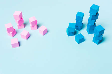 Blue and pink cubes. The concept of sexism, feminism and equality. Soft focus