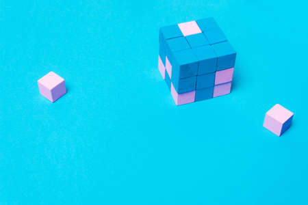 Geometric cube of blue, male and pink female parts. The concept of equality, sexism, feminism, creativity
