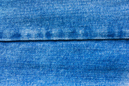 Abstract background, texture with embroidered denim blue fabric