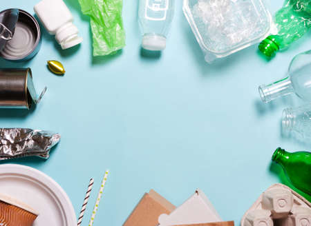 Household waste on a blue background. The concept of sorting plastic, polyethylene cardboard, paper, glass. Protection of the environment, ecology Stock Photo