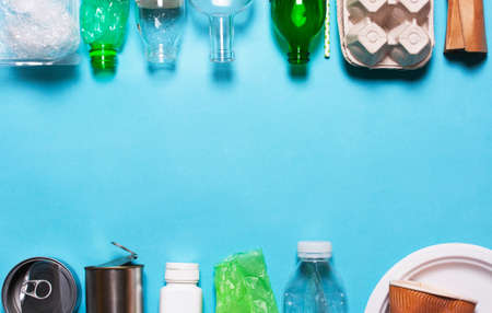 Household waste on a blue background. The concept of sorting plastic, polyethylene cardboard, paper, glass. Environment protection Stock Photo