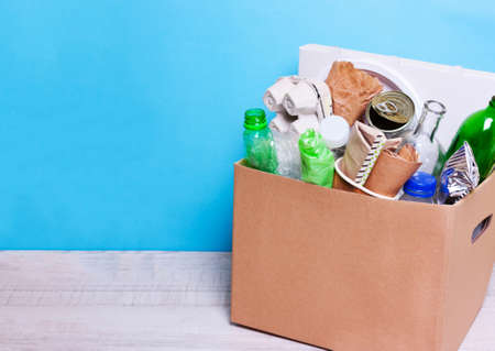 In a cardboard box plastic, glass bottles, cans, paper. The concept of separate sorting of garbage, environmental protection, ecology, recycling household waste