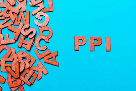 abbreviation PPI - Payment Protection Insurance.Wooden letters on blue background
