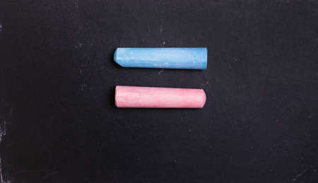 Blue and pink chalk on a blackboard, symbol of equality of women and men. Feminism Stock Photo