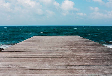 Wooden old bridge, pier, pier in the sea, ocean.Summer background with copy space