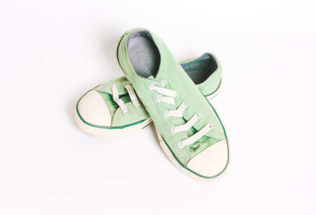 Vintage old green sneakers, shoes. Concept of multiple trips, free life, tourism Stock Photo