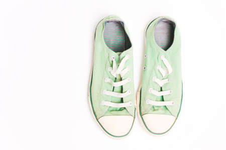 Old green sneakers, shoes. Concept of multiple trips, free life, tourism
