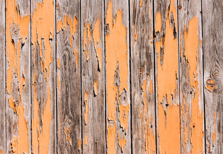 Old wooden background with shabby orange paint