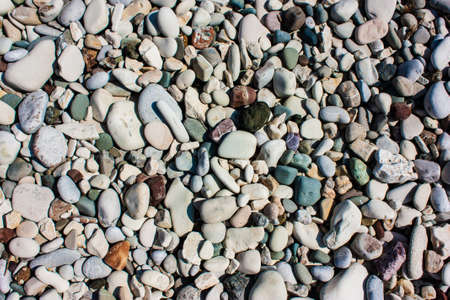 Marine naturally rounded gravel, pebbles. Nature Background Texture