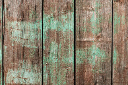 Old vintage wooden background with shabby green paint Stock Photo