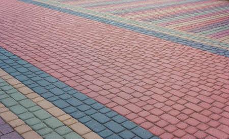 Mosaico de adoquines modernos con estilo de color. Hermoso fondo abstracto. Camino de piedra de la ciudad