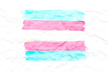 Transgender flag on white crumpled paper. Blue, pink. Stock Photo