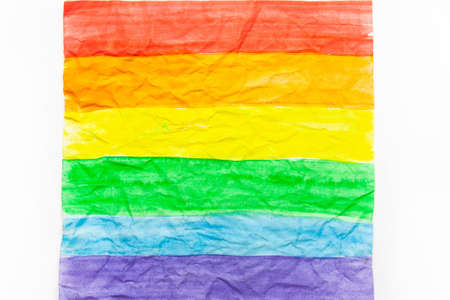 LGBT flag on white crumpled paper.