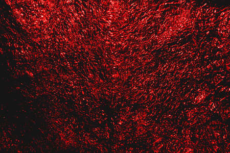 Red dark hellish  Halloween grunge abstract crumpled aluminum, titanium shiny foil background Stock Photo