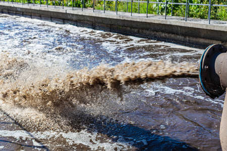 Treatment plant. City sewer. Dirty water flows from the pipes. Environmental pollution. Cleaning Zdjęcie Seryjne