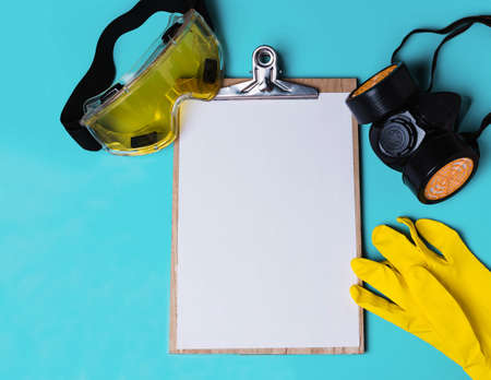 Protective mask, yellow rubber gloves and mask.Remedies. Template, layout, paper for writing text
