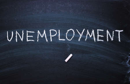 The word unemployment written in chalk. Concept of hiring, new job, vacancy,