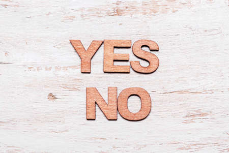 Words yes no in wooden letters. The concept of choice, decision, consent, denial Standard-Bild