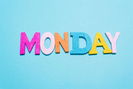Word MONDAY in multicolored letters on a blue background