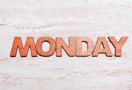 Word monday in wooden letters on blackboard Standard-Bild