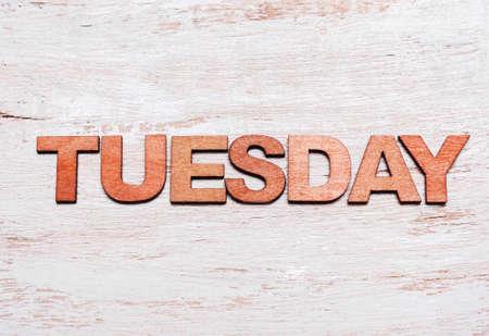 Word tuesday in wooden letters on blackboard