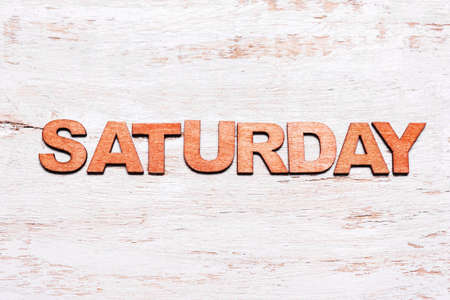 Word saturday made of wood letters on blackboard