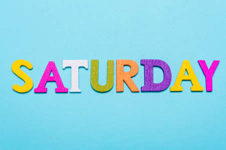 Word saturday made of colorful letters on a blue background