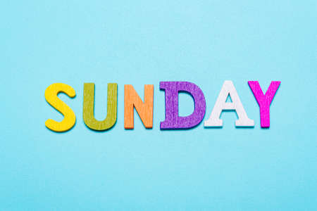 Word Sunday made of colorful letters on a blue background