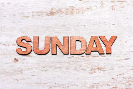 Word sunday made of wooden letters on blackboard