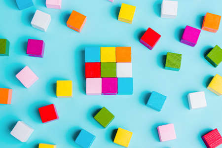 Chaotically disorganized colored cubes and ordered. The concept of business model, structure, logical solution of the organization. order and chaos. Stock Photo