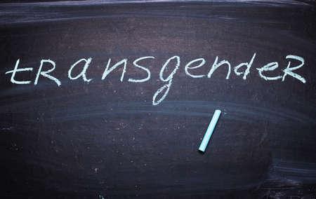 The word Transgender written in chalk on a blackboard. Standard-Bild