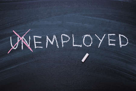 The word unemployed written in chalk. Concept of hiring, new job, vacancy, unemployment.