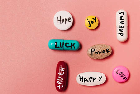 The concept of creative pills, a placebo with joy, love, happiness, truth, power, dream on  pink Standard-Bild