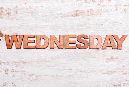 Word Wednesday in wooden letters on a blackboard