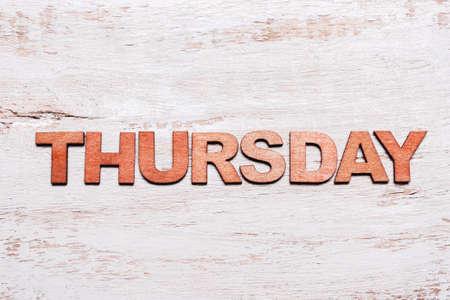 Word thursday in wooden letters on blackboard