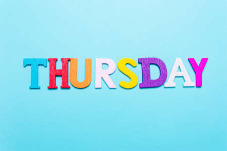 Word Thursday in colorful letters on a blue background