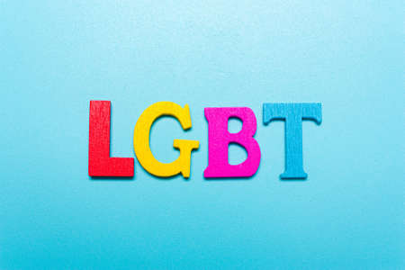 LGBT word from rainbow color letters on  blue Standard-Bild