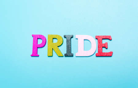 PRIDE word from rainbow color letters on  blue Standard-Bild