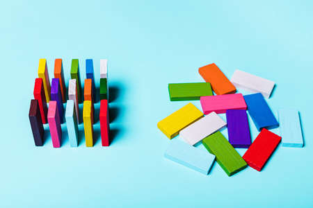 order and chaos. Chaotic unorganized colored dominoes and ordered. Concept of business model, organization. Left and right