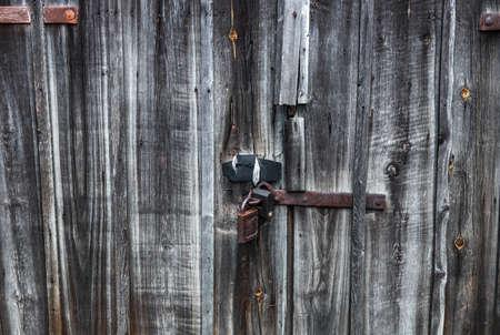 Old, vintage, closed, rural grunge wooden doors with a lock Standard-Bild
