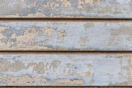 Gray, beige old grunge wall with peeled plaster