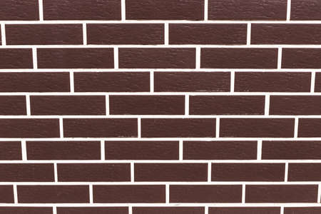Brown smooth brick wall in a row.