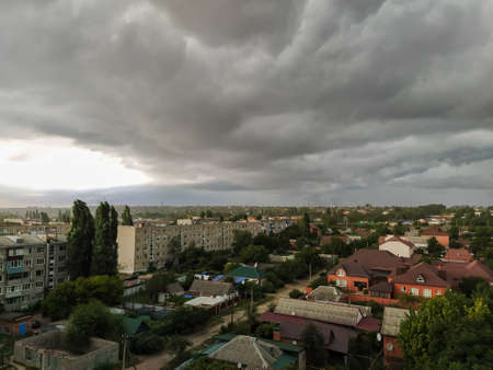 Dark storm clouds over the city