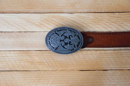 Leather cowboy belt on a wooden background