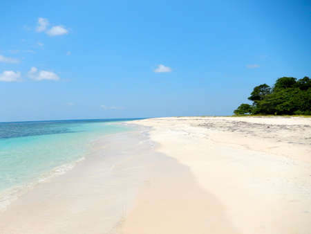island paradise: beach and tropical sea with clear water. travel to paradise Stock Photo