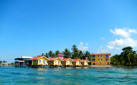 colorful floating houses and boats in the caribbean photo
