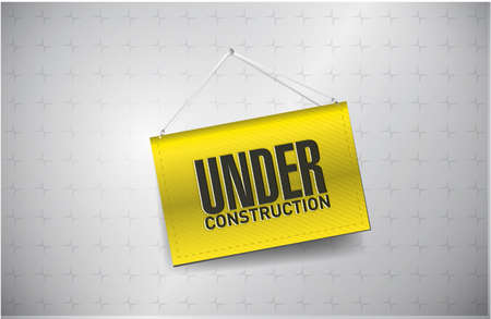 under construction sign hung on a textured background photo