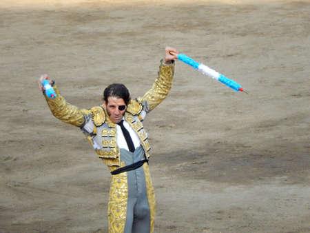 capote: LIMA, PERU - NOV 2013: famous Spanish torero Juan Jose Padilla. Brave bullfighter. Banderillas
