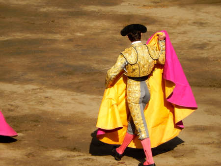 courageous: Bullfighter in the ring. brave matador with capote. arena