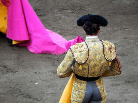 capote: Bullfighter in the ring. brave matador with capote